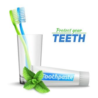 С зубными щетками в стеклянной и мятой зубной пасте