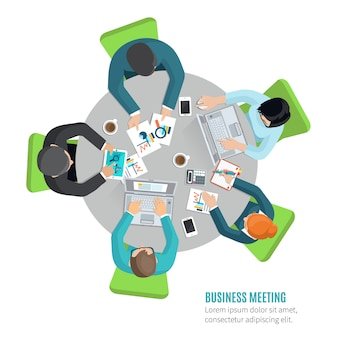 オフィステーブルに座っているトップビューの人々とビジネス会議のコンセプト