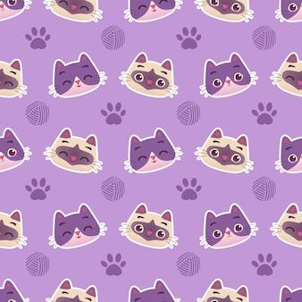 足と糸のボールのシームレスなパターンを持つかわいいカラフルな猫子猫