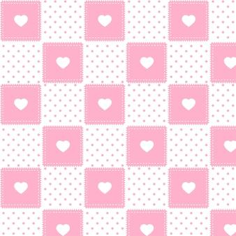 かわいいピンクのドットと心のシームレスパターン
