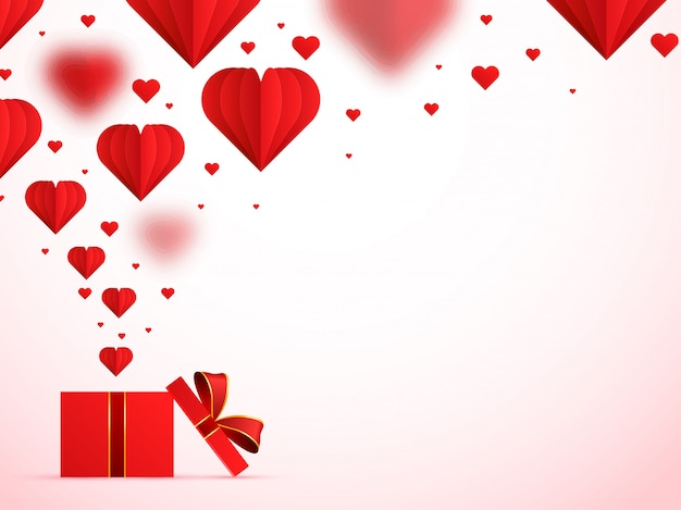 ハッピーバレンタインデーの背景に赤い紙の心。