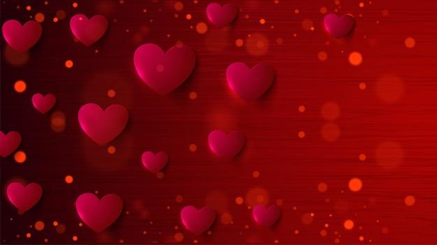 紙のハートの形のバレンタインの赤い背景のボケ味を装飾
