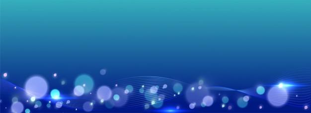 光沢のある青い色の照明効果の抽象的な背景のボケ味