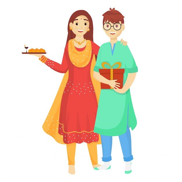 Младший брат и сестра празднуют по случаю ракшабандхана.