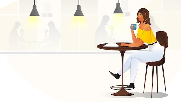 カフェで若い女の子。