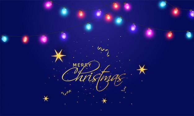 Золотое с рождеством христовым с освещенной гирляндой освещения.