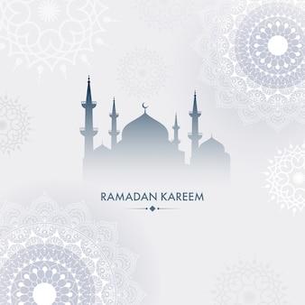 灰色の背景にモスクとマンダラ花柄のシルエット。ラマダンカリームのコンセプトです。
