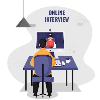 オンラインの就職の面接の募集のために職場でデスクトップから女性にビデオ通話をしている男性の背面図。