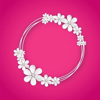 ピンク色の背景に白い紙の花。