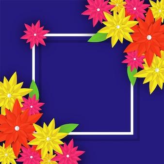 青い背景に白い正方形のフレームとカラフルな紙の花。