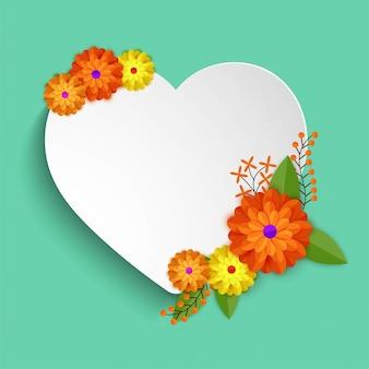 カラフルな花で飾られた白い紙の心。
