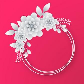ピンクの背景に円形のフレームと白い紙の花。