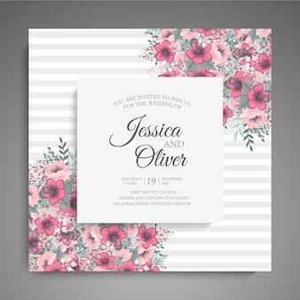 ピンクの花を持つ結婚式の招待カードテンプレート。