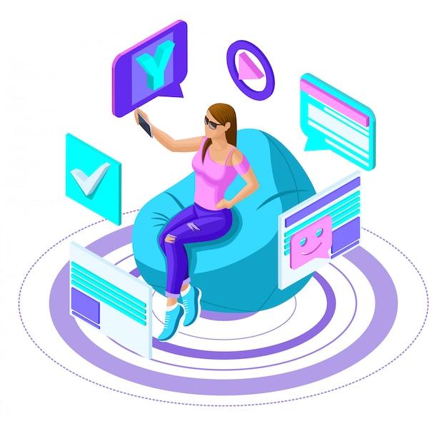 はスマートフォンを持つ若い女の子で、ソーシャルネットワークでブログをリードし、ビデオを記録し、自撮りをしています。明るい広告コンセプト