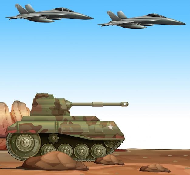 Два боевых самолета и боевой танк в поле битвы