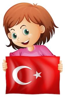 トルコの国旗を持っている少女