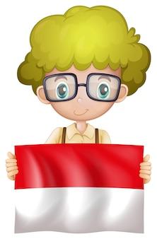 旗を持つインドネシアの男の子