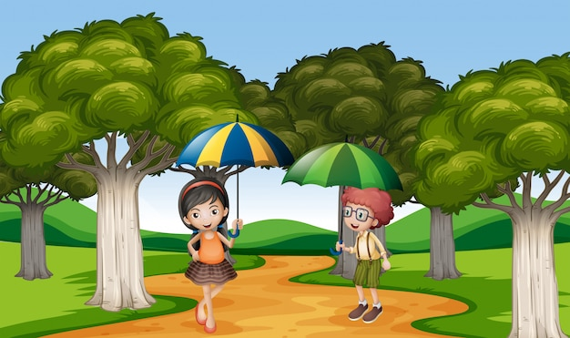 Двое детей с зонтиком в парке