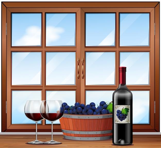ぶどうの背景のバレルと眼鏡の赤ワイン