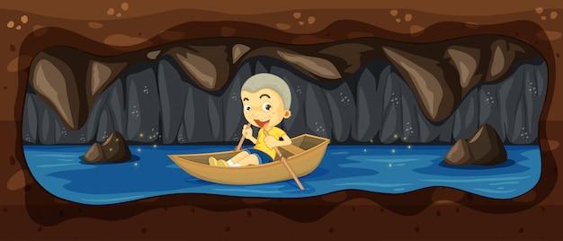川の洞窟でボートに乗っている子供