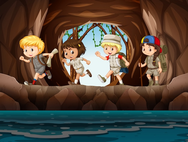 洞窟を探索する若い子供のスカウト