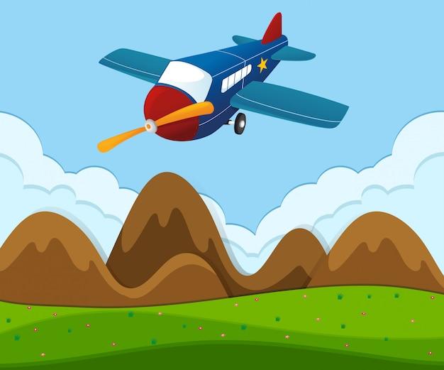 緑の風景を飛んで飛行機