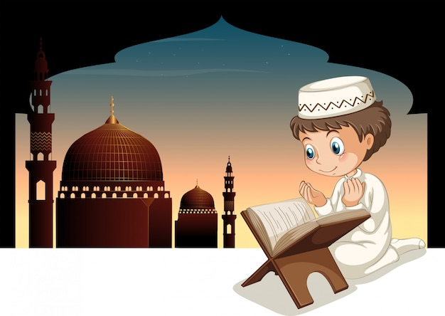 モスクの背景と祈るイスラム教徒の少年