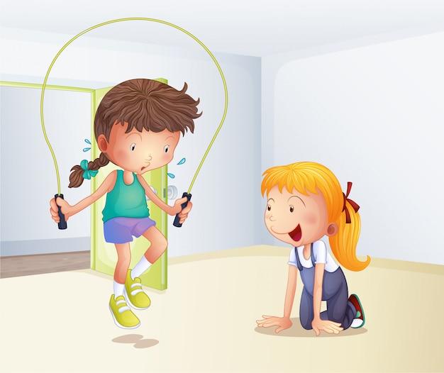部屋の中で飛び跳ねているロープを弾いている女の子