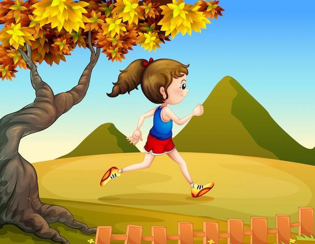 丘でジョギングする女性