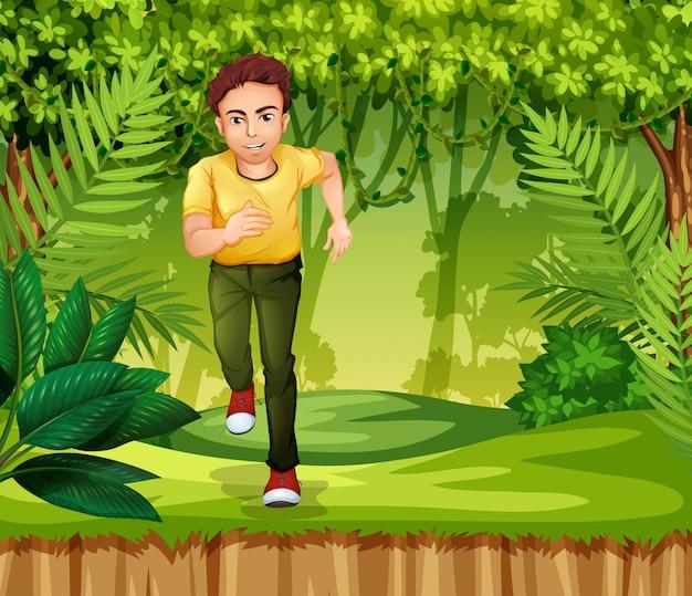 ジャングルで走っている若い男
