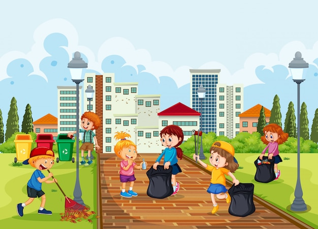 公園を掃除するボランティアの子供たち