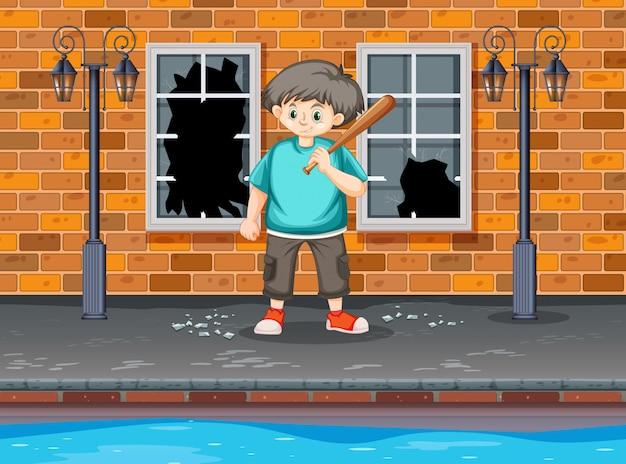 若い男の子が窓を打つ