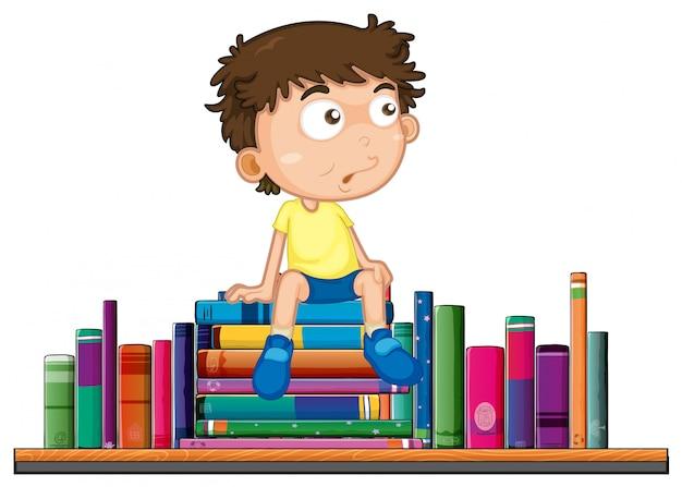 少年は本の山に座っている