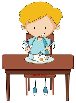朝食を食べる落書き少年