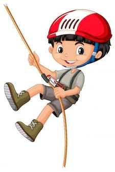 ロープを登る少年