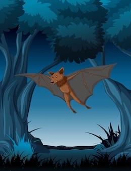 夜の森を飛んでいるコウモリ