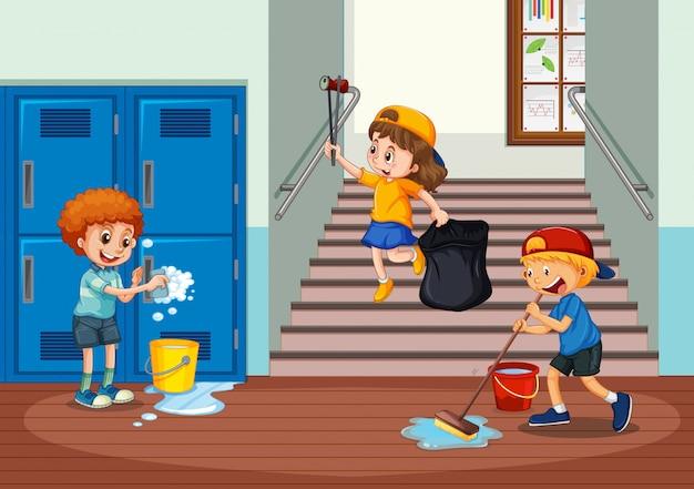 学校の廊下を掃除するボランティアの子供たち