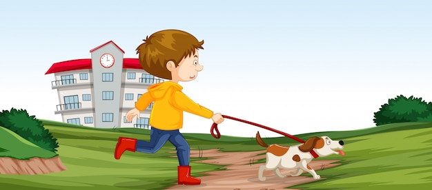 彼の犬のシーンを歩いている少年