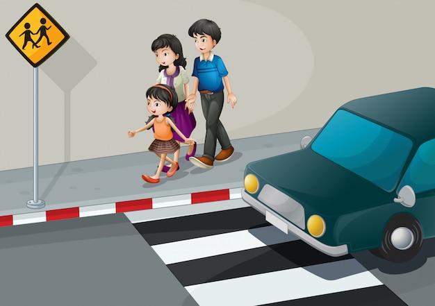 通りを歩いている家族
