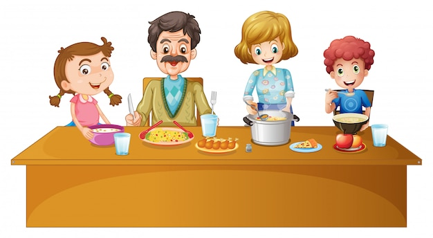 テーブルで夕食を食べている家族