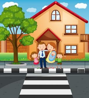家の前に立っている家族
