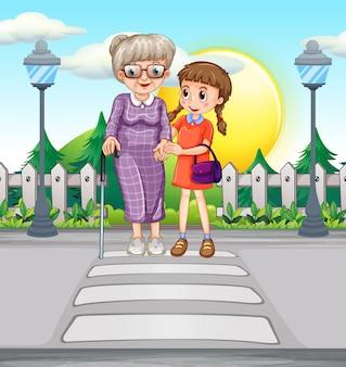Девушка помогает пожилой женщине переходить дорогу