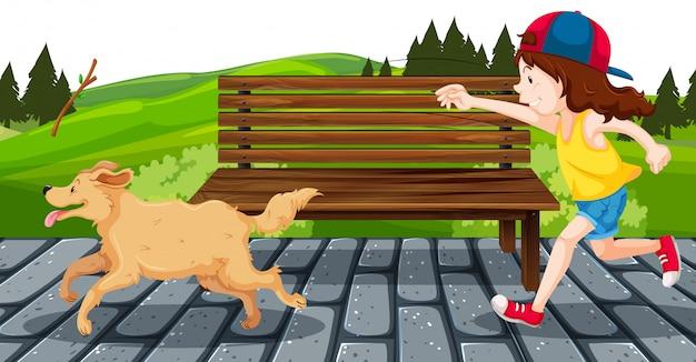 公園で犬を持つ少女