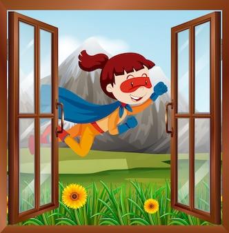 窓の上を飛んでいる女性のスーパーヒーロー
