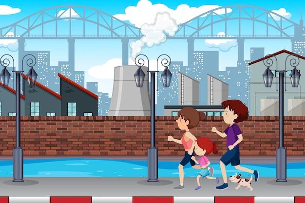 町でジョギングする家族