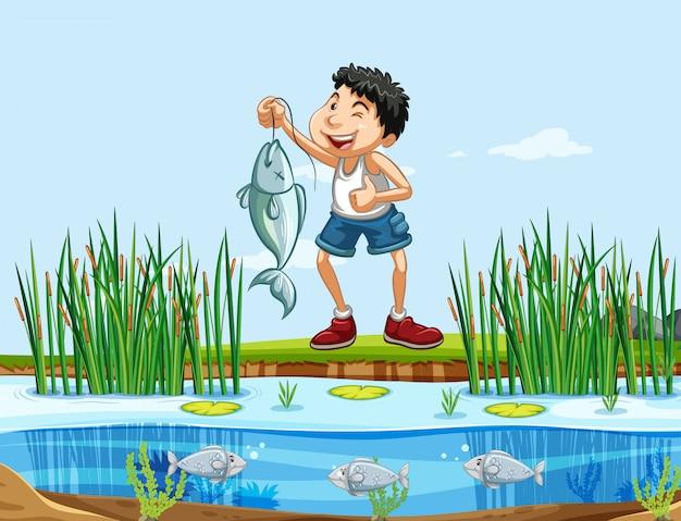 幸せな男が自然の中で釣り