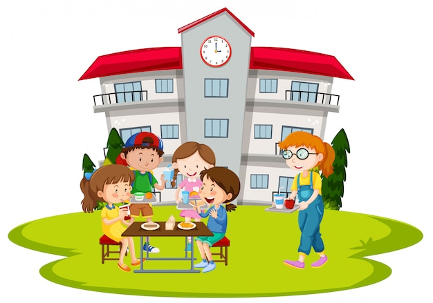 学校で昼食をとる子どもたち