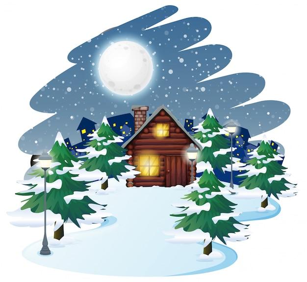 冬のバックグラウンドでの小屋