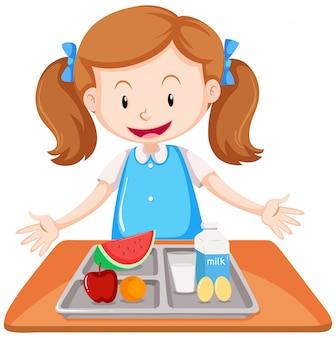 テーブルの上に昼食をとった女の子