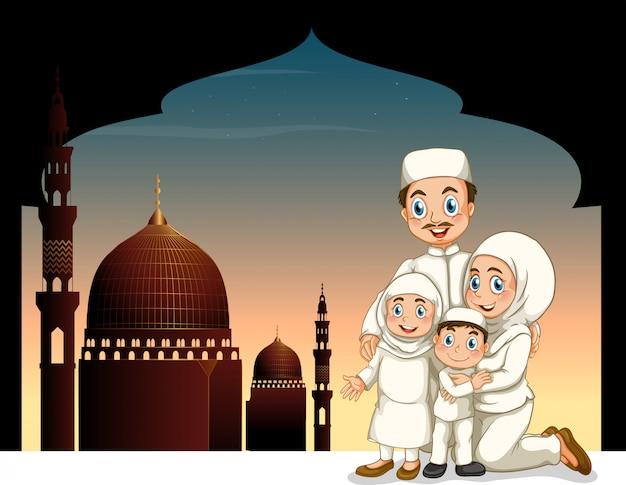 モスクの背景を持つイスラム教徒の家族